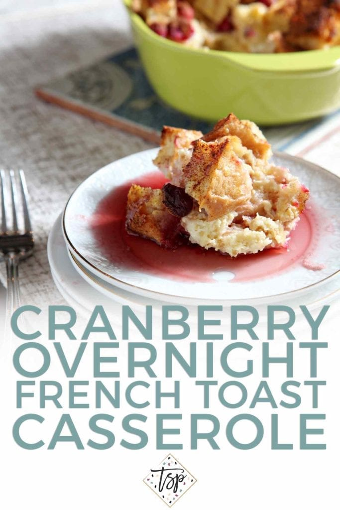A serving of Cranberry Overnight French Toast sits on a white plate, covered in cranberry syrup, with Pinterest text