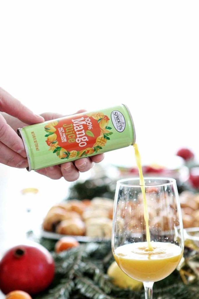 Mango juice is poured into