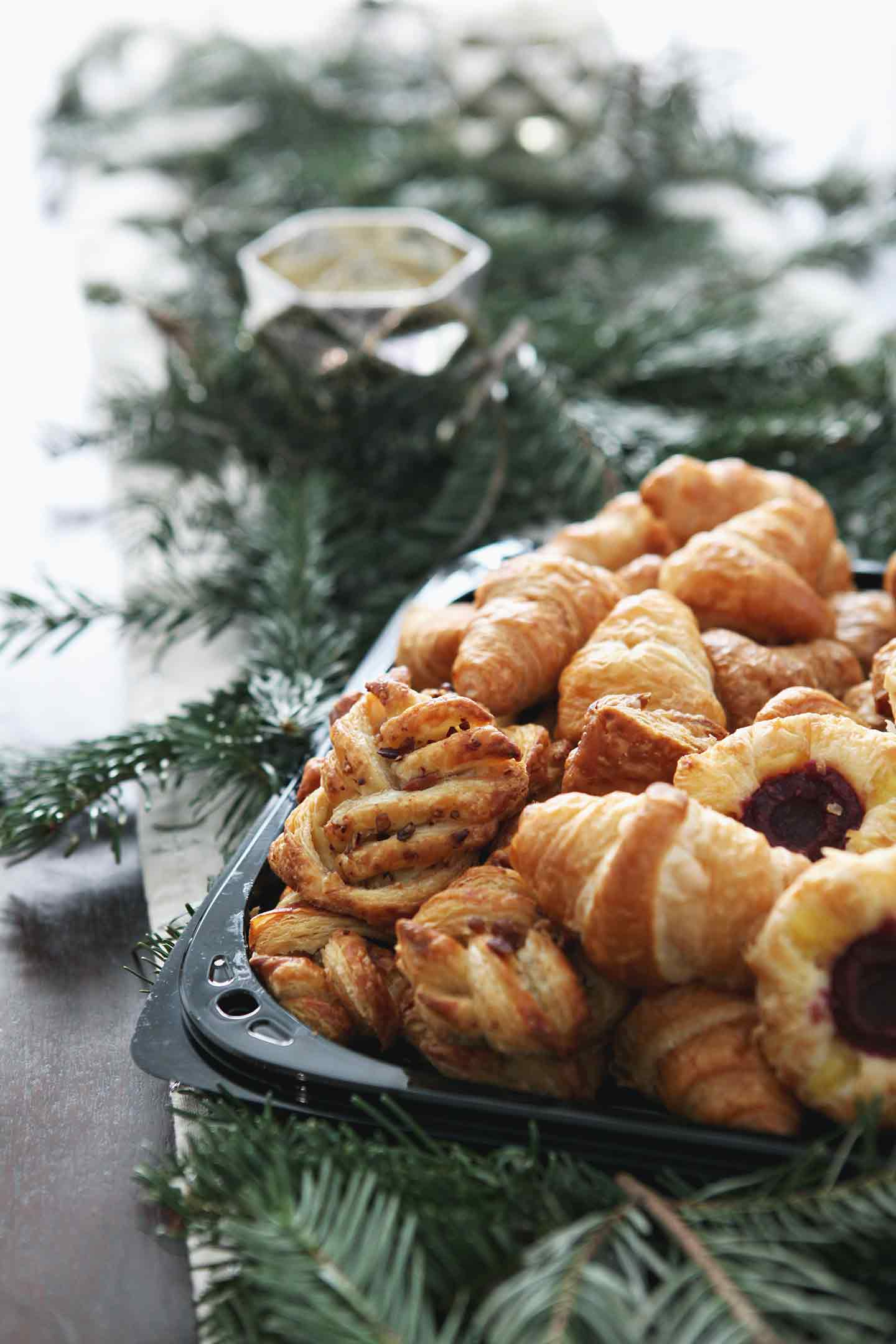 Pastries are shown in their packaging from Sprouts before being moved to a serving platter