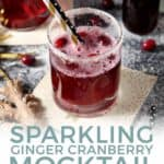 Pinterest graphic, featuring Two Sparkling Ginger Cranberry Mocktails are shown on a dark background, surrounded by fresh cranberries and ginger and text