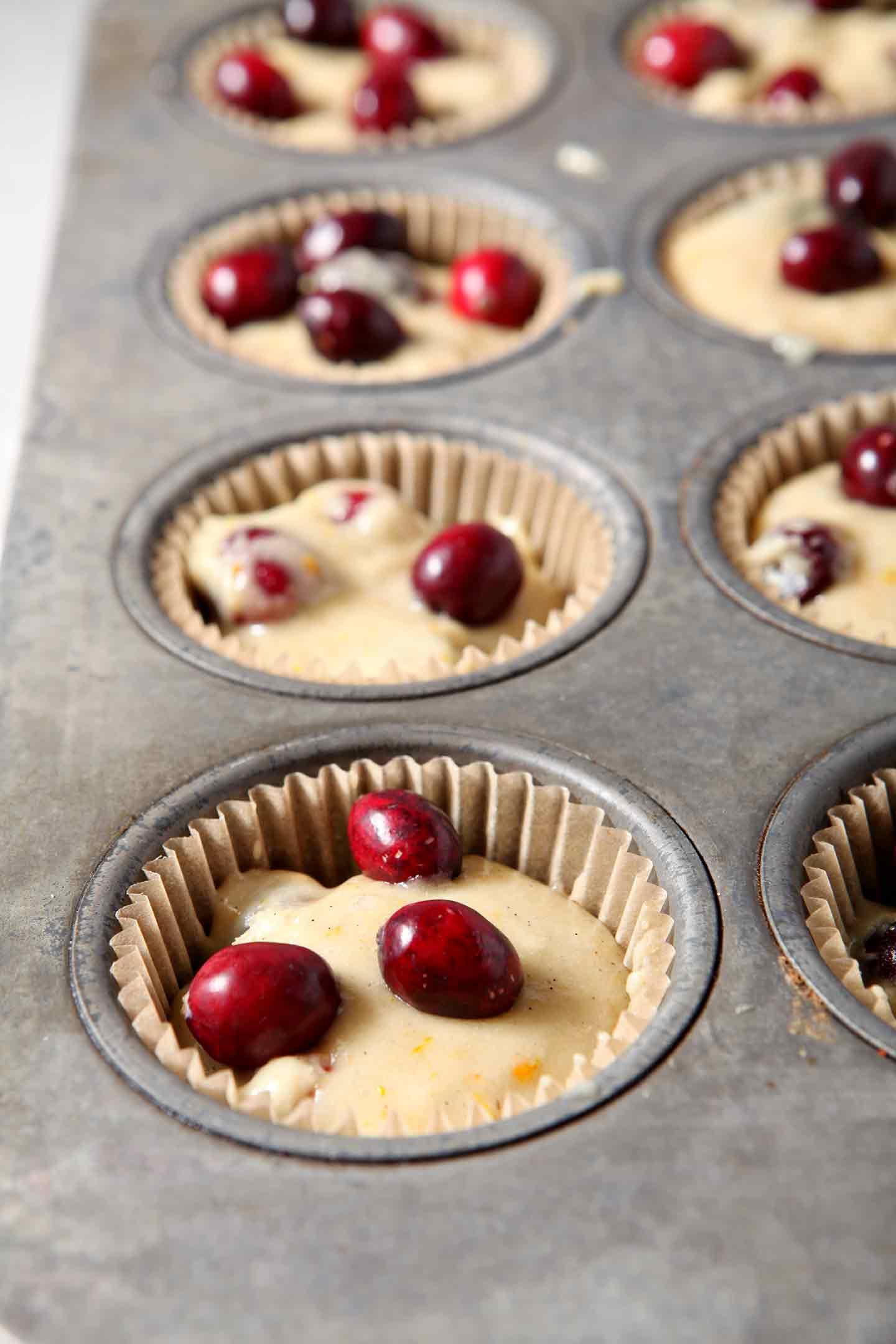 Close up of Vegan Orange Cranberry Muffins in a muffin tin, before baking