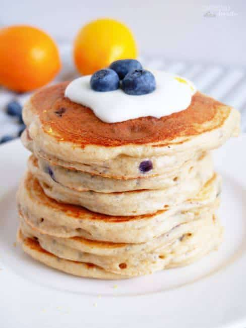 A stack of Blueberry Protein Pancakes sits on a white plate