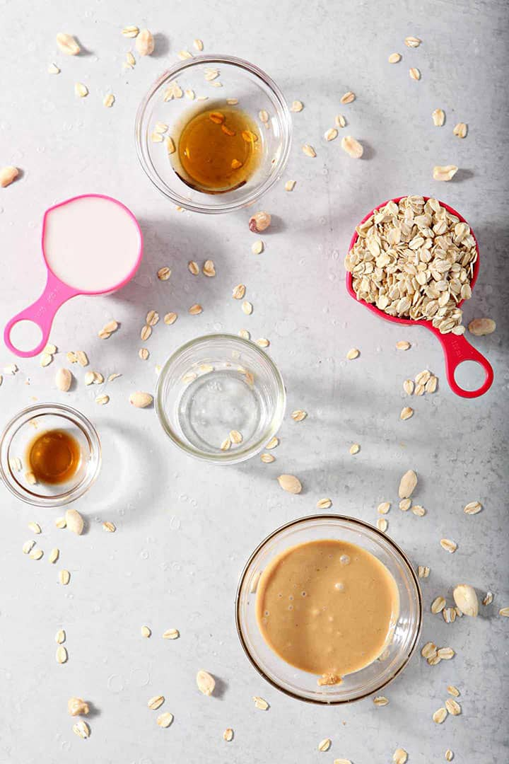 Ingredients for Peanut Butter Overnight Oats are laid out on a grey board