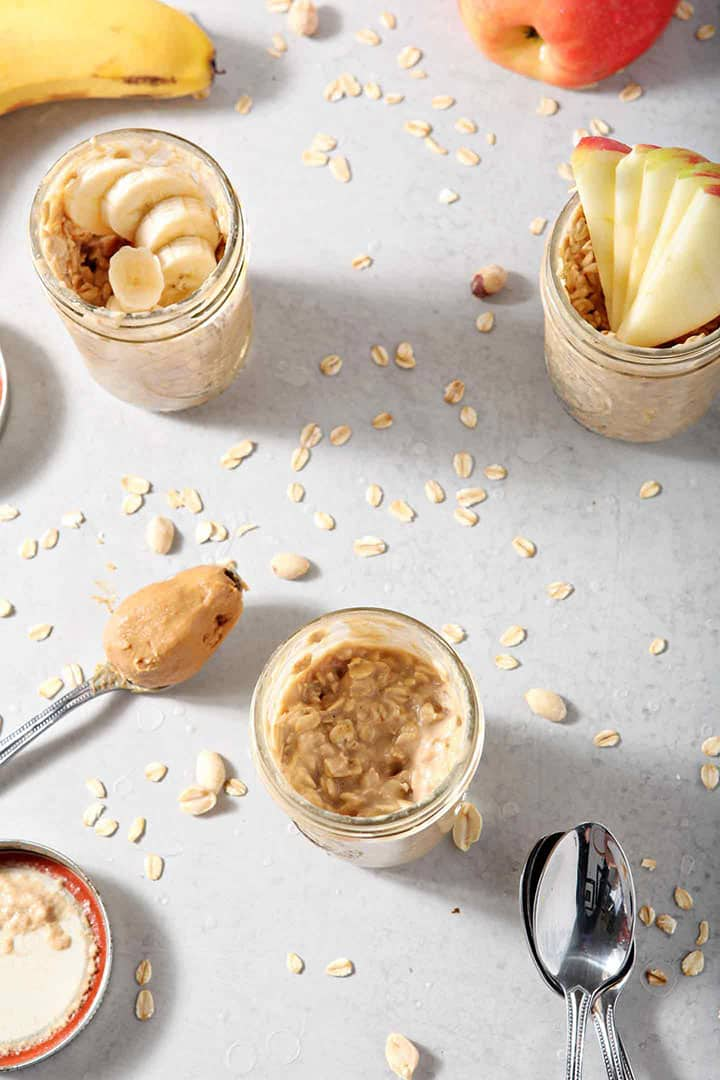 Three jars of Peanut Butter Overnight Oats are shown from above