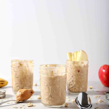 Three jars of Peanut Butter Overnight Oats are shown on a grey background with various toppings