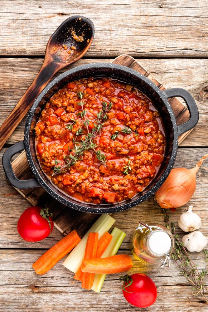 Instant Pot Vegetable Bolognese is shown in a pot from above on a wooden background