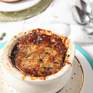 Close up of Instant Pot French Onion Soup in a crock after broiling