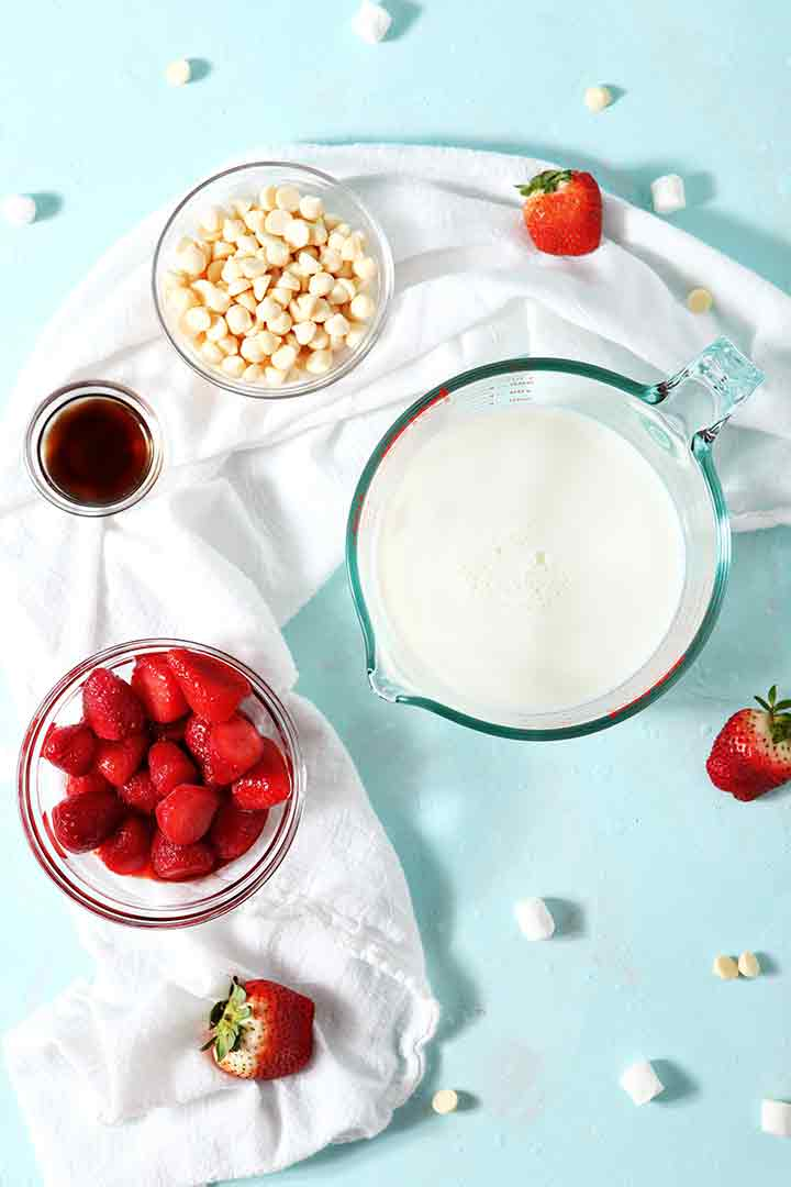 Ingredients for Strawberry White Hot Chocolate on a turquoise background