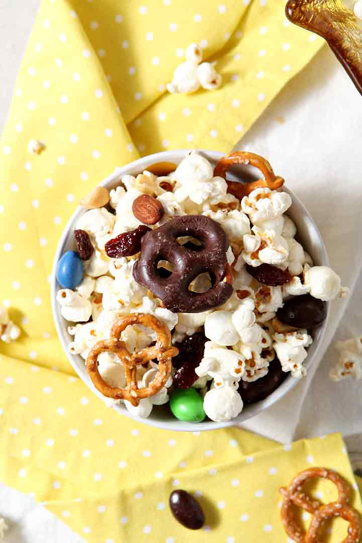 Close up of an individual bowl of the popcorn snack mix