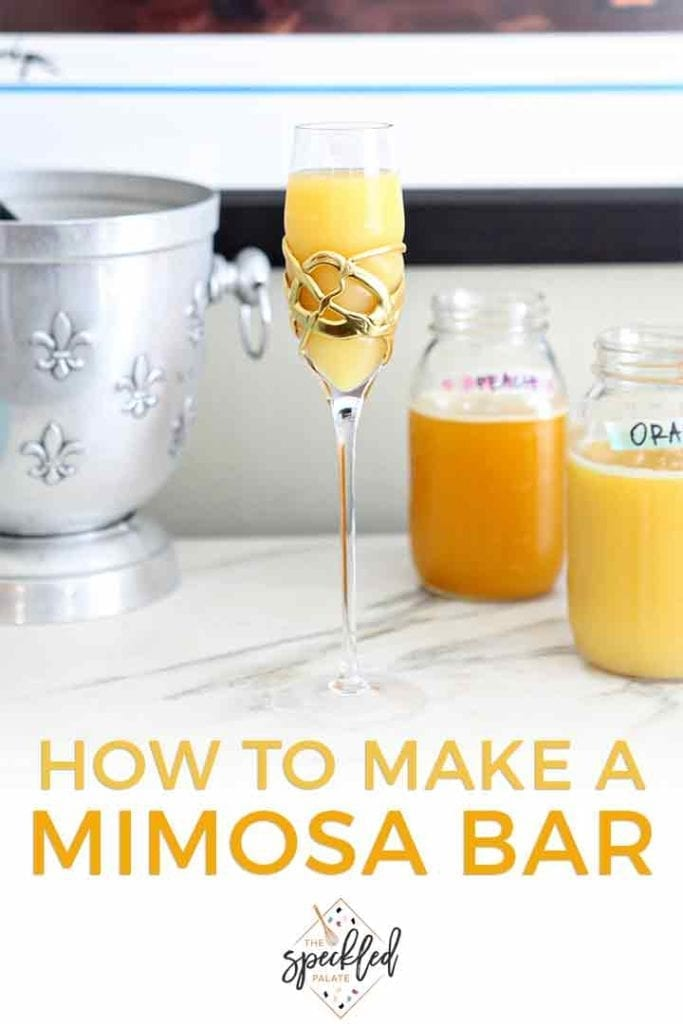A mimosa sits on a marble slab at a home bar at a home brunch