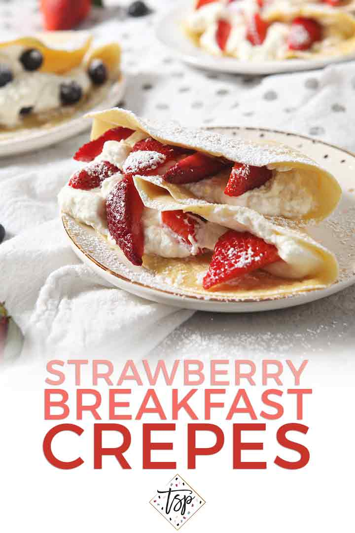 Strawberry Breakfast Crepes are served on a plate with Pinterest text