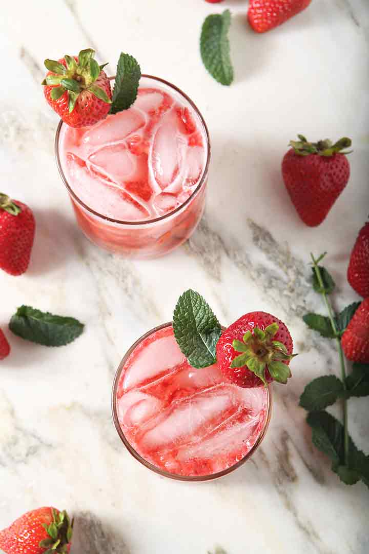 Overhead image of two Strawberry Mules, garnished and ready for drinking