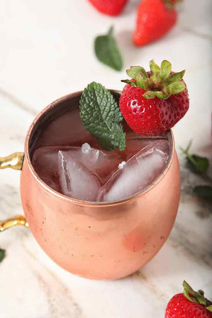 Close up of a Strawberry Moscow Mule in a copper mug