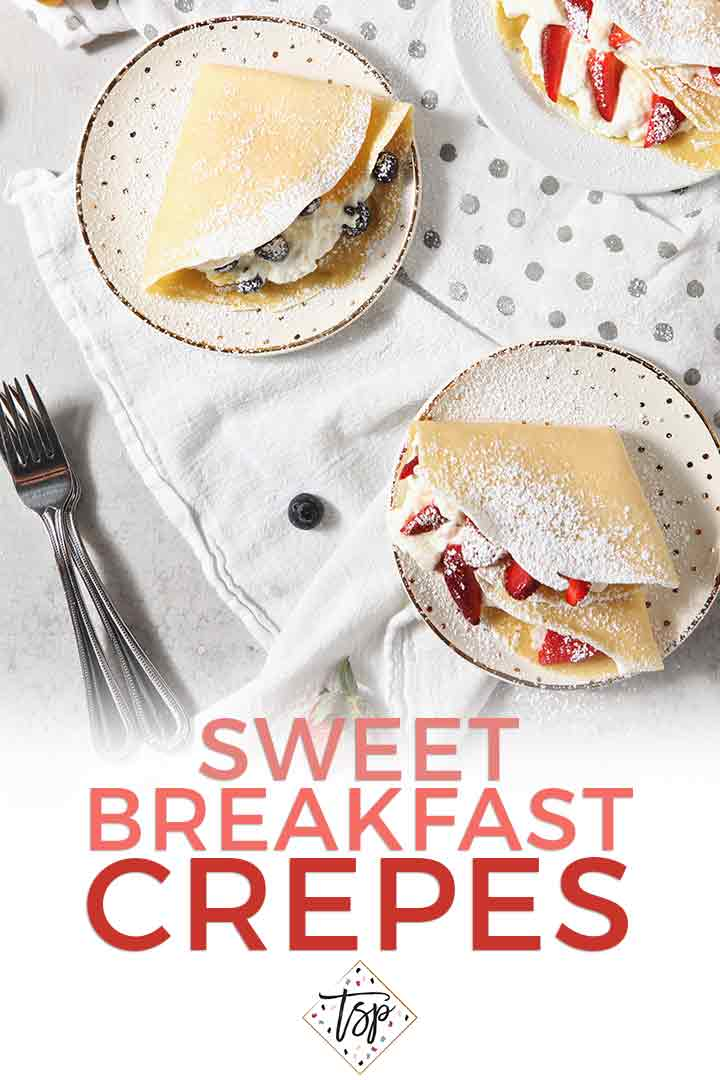 Whip up homemade Sweet Breakfast Crepes for brunch! Light and flavorful, these crepes are filled with lemon whipped cream, blueberries and strawberries. | Spring Brunch | Summer Brunch | Brunch Recipe Inspiration | Homemade Crepes | Strawberry Crepes | Blueberry Crepes | Whipped Cream Crepes | #SpringSweetsWeek #speckledpalate #ad
