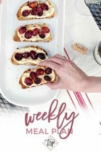 Pinterest photo for Dinner Divas Weekly Meal Plan 106, featuring a woman grabbing a slice of Roasted Grape Bruschetta