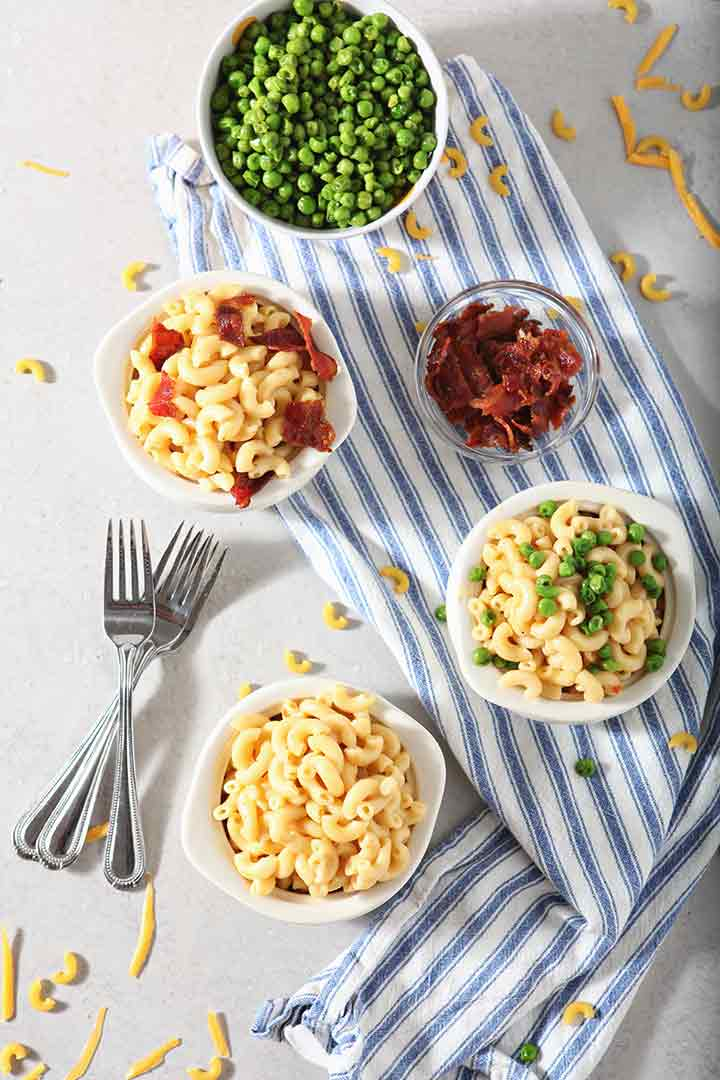 Bacon and peas are added to bowls of Instant Pot Macaroni and Cheese to give seasonal variety