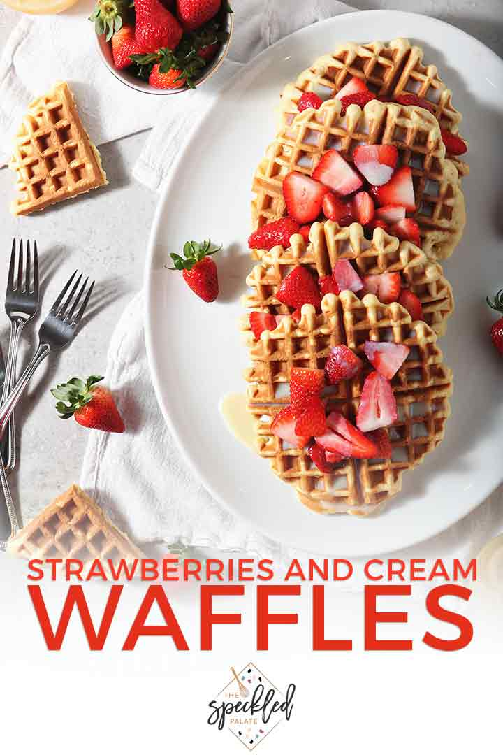 Pinterest photo of Homemade Waffles with Strawberries and Cream, shown from above on a platter