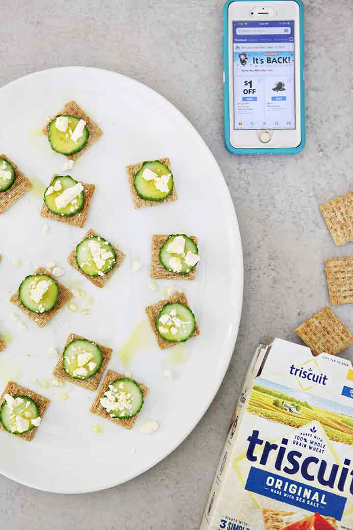 A platter of Cucumber Bites is shown with a mobile phone and TRISCUIT crackers spilling out of a box