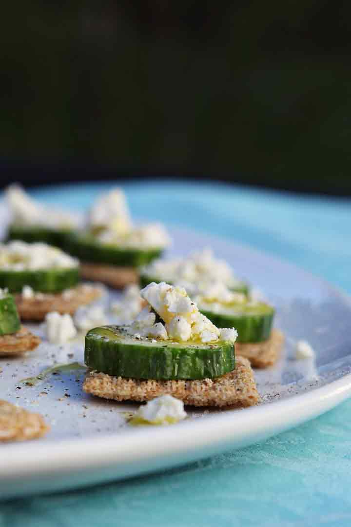 Close up of the cucumber appetizer on a white platter outdoors