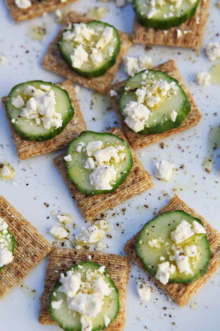 A close up of TRISCUIT Cucumber Appetizer from above on a white platter