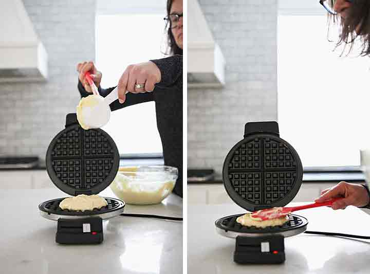 A woman makes waffles in a waffle iron