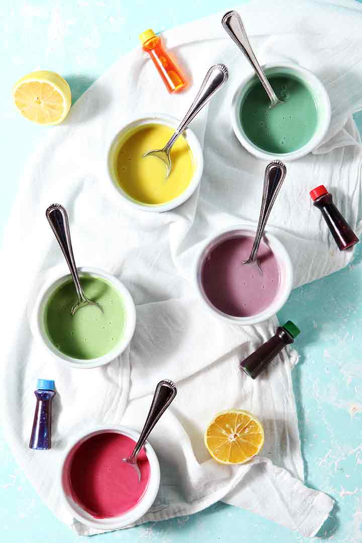 Colorfully dyed Lemon Icing in containers, ready for decorating cookies