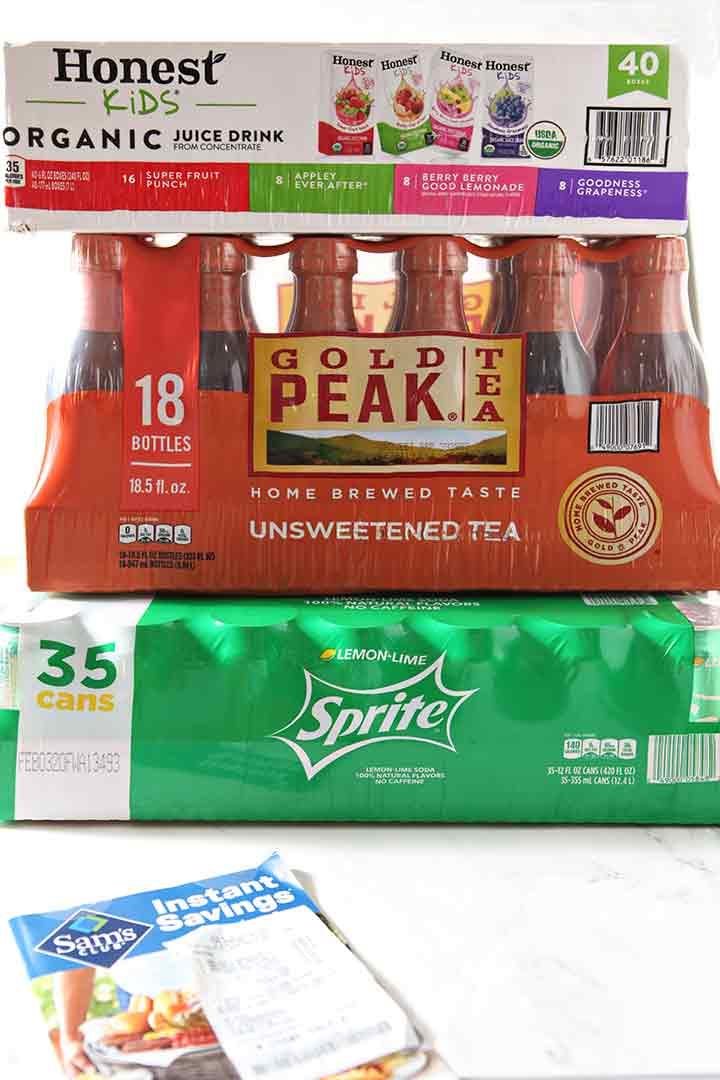 Honest Juice, Gold Peak Tea and Sprite packages are stacked on top of one another
