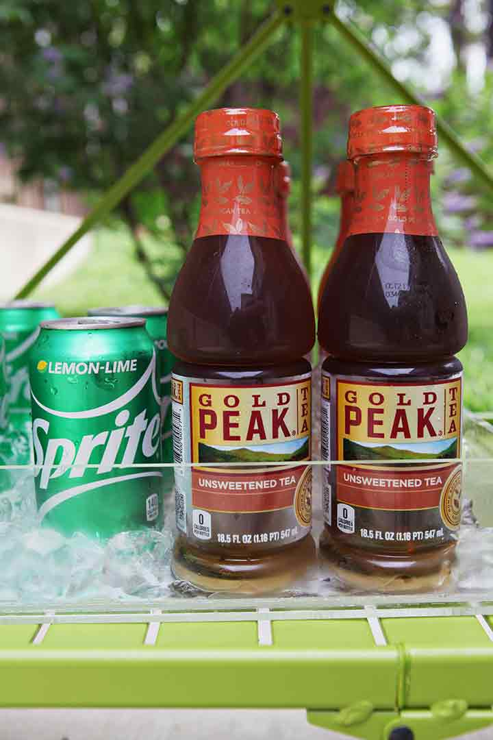 Close up of Gold Peak Unsweetened Teas and Sprite on a bar cart