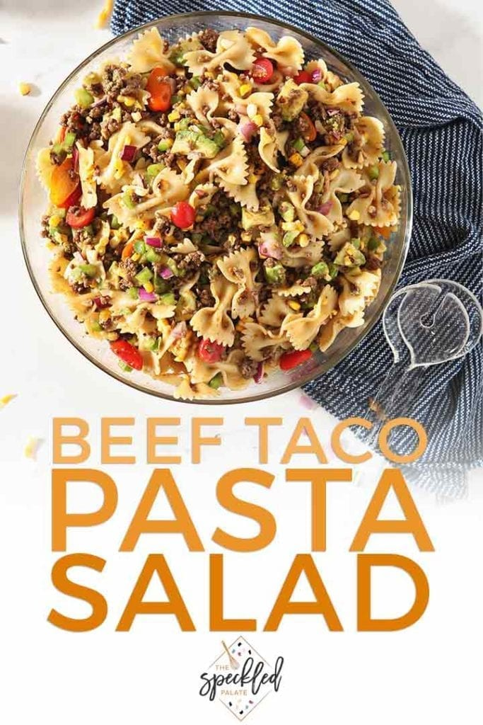 Pinterest image for Beef Taco Pasta Salad, featuring a close up of the tossed salad