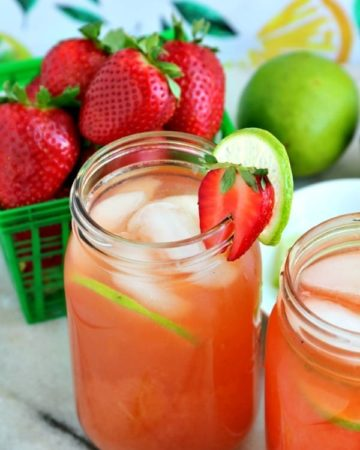 strawberry limeade in a mason jar and a box of strawberries
