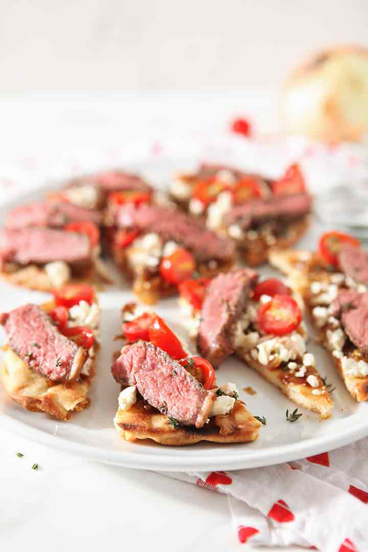 Close up of Grilled Steak Flatbread, sliced