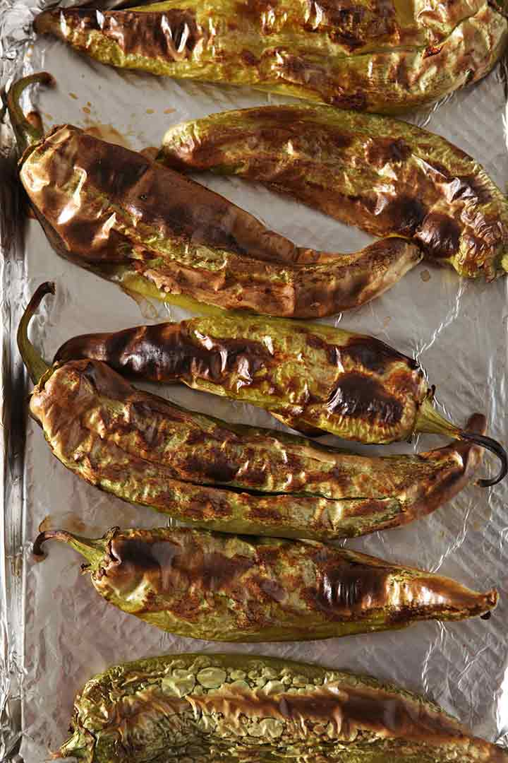 The final roasted peppers, on a baking sheet, after broiling