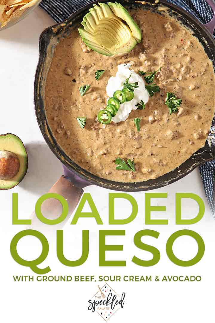 Loaded Queso is the best entertaining appetizer! This homemade queso blanco is studded with ground beef and garnished with avocado, sour cream and jalapeño rounds. No shelf-stable cheese or canned milk necessary! | Cheese Dip | Easy Entertaining | #queso #speckledpalate #ad
