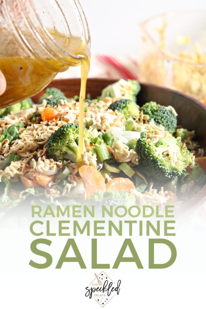 Dressing is drizzled on top of a Ramen Noodle and Clementine Salad, with Pinterest text