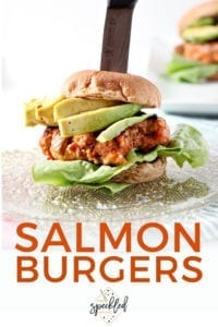 A Salmon Burger is speared with a knife, ready for eating, with Pinterest text