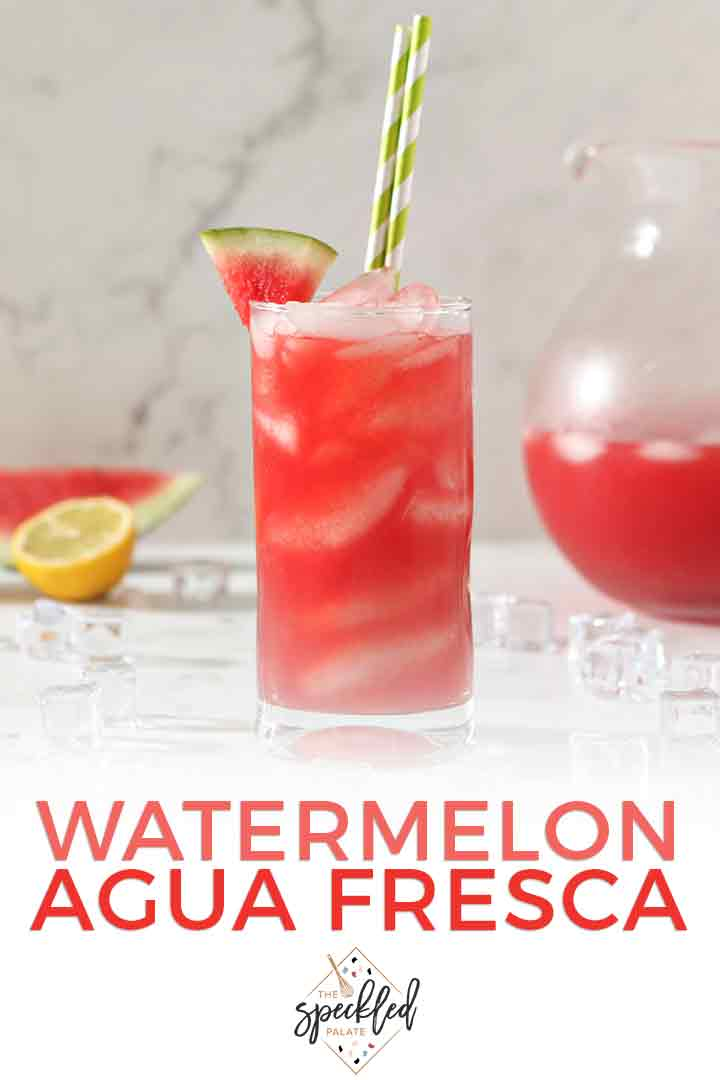 Close up of a glass of Watermelon Agua Fresca, surrounded by ice, with Pinterest text