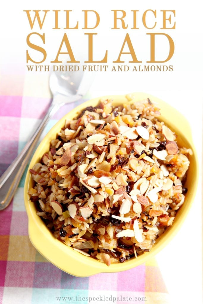 Wild Rice Salad with Dried Fruit and Almonds from above in a serving dish, with Pinterest text