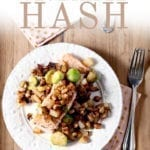 Overhead of Winter Vegetable Hash, served on a salmon filet, with Pinterest text