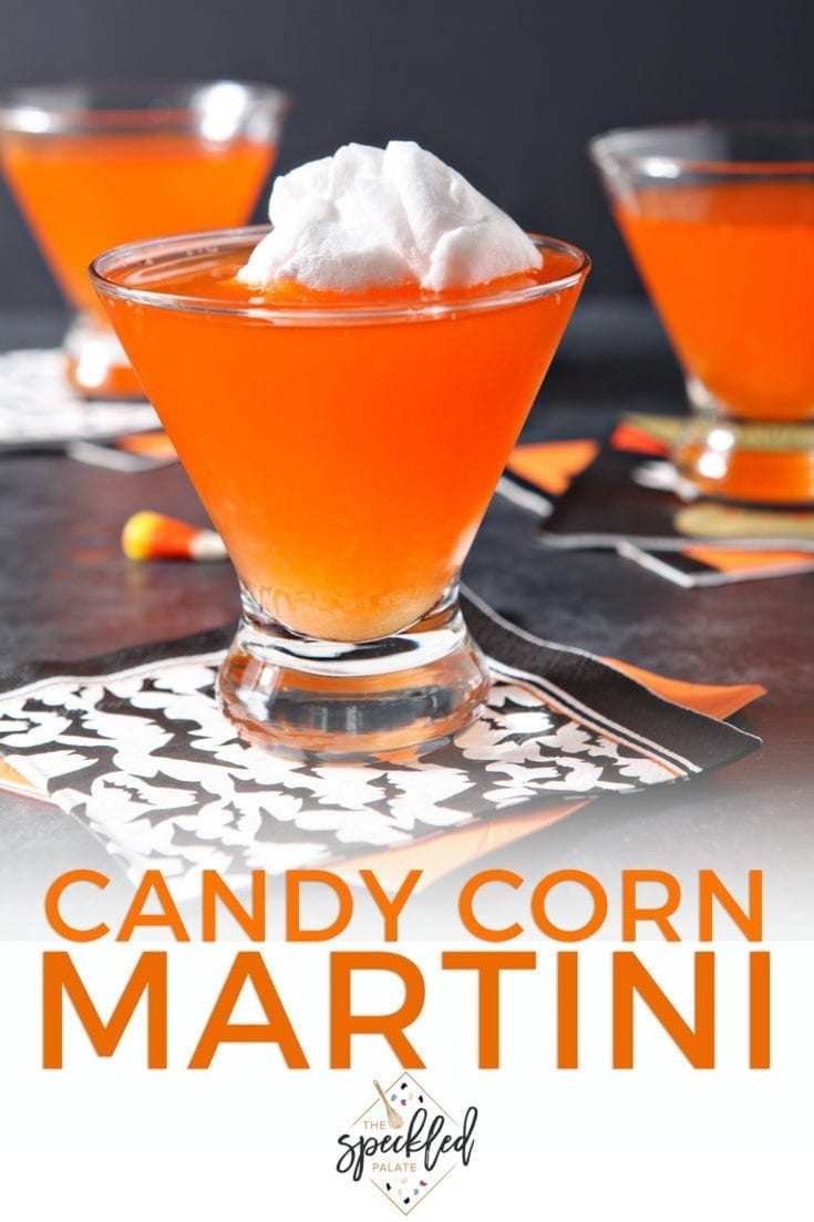 Celebrate Halloween in style by mixing up a Candy Corn Martini! This festive martini features homemade candy corn-infused vodka and more! #cocktail #speckledpalate