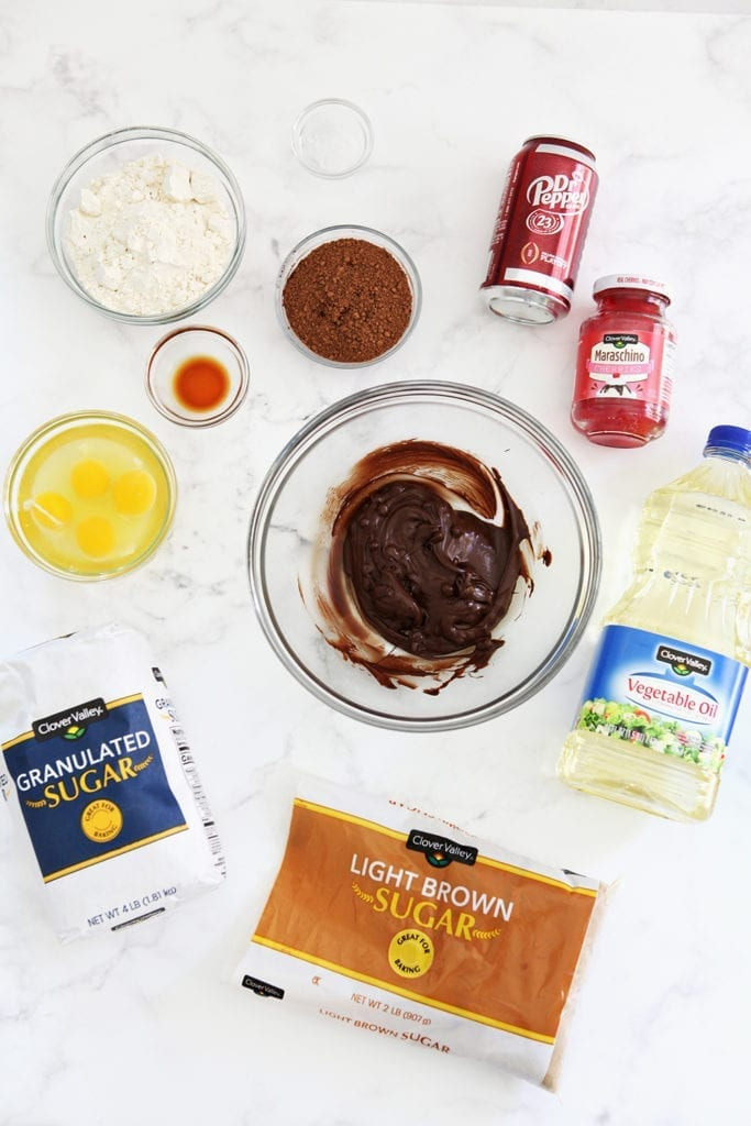 Ingredients for the brownies are laid out on a marble background