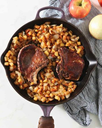 Cinnamon Apple Pork Chops in a skillet, after everything is finished cooking