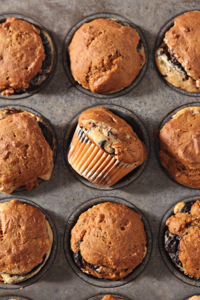 Easy Pumpkin Muffins, shown in the muffin tin, cool before they are enjoyed