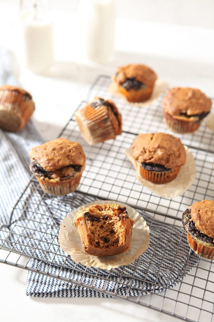 Several Easy Pumpkin Muffins with Cream Cheese and Nutella Swirl cool on a wire cooling rack