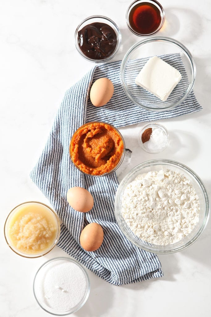 Ingredients for muffins are laid out on a marble background