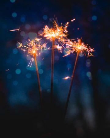 Sparklers, on a dark background