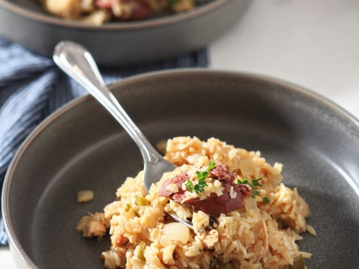Close up of a bowl of Chicken and Sausage Jambalaya, with a fork