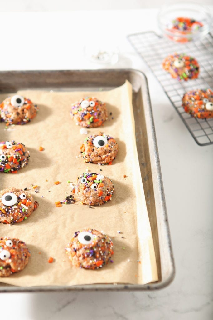 Halloween Funfetti Cookies on a sheet pan, after baking