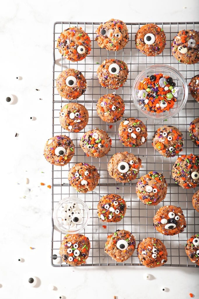 Cookies on a cooling rack, with extra sprinkles
