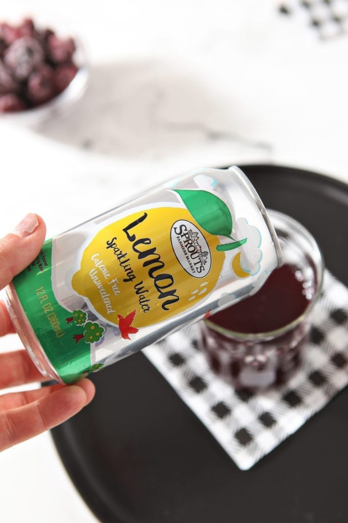 Sprouts Sparkling Water is poured into a glass, from above