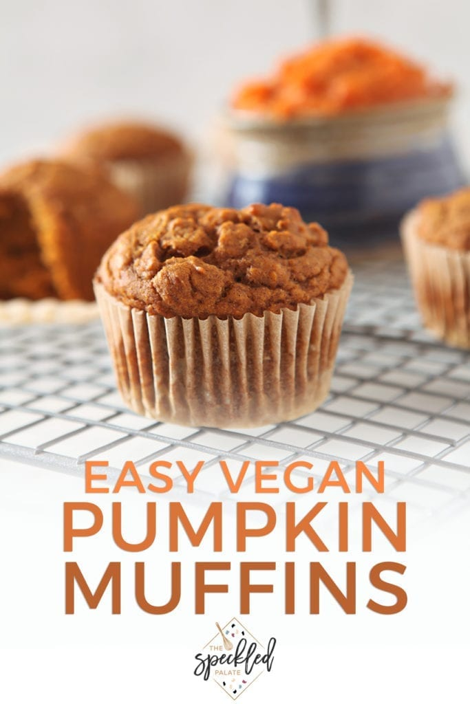 Several muffins on a wire cooling rack with the text 'easy vegan pumpkin muffins'